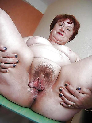 redhead hair granny with big tits posing uncovered
