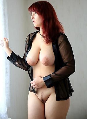 redhead granny stripping love posing nude