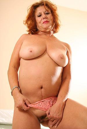 older hot redheaded column posing nude